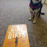 Chihuahua with book The Girl With All The Gifts
