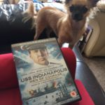 Chihuahua with our copy of USS Indianapolis Men of Courage
